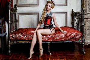 Blonde Woman in medieval corset historic dress and lingerie po